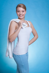 Attractive woman holding big white towel
