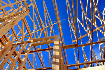Wood frame residential structure under construction.