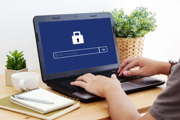 Man typing password on labtop screen background, cyber security concept