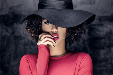 Portrait of african american girl in hat. Wall mural