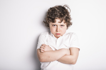 Head and Shoulders Close Up Portrait of Young boy with Sulk attitude