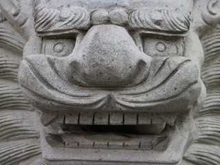 Stone dragon head close up in horizontal 3:2 format.