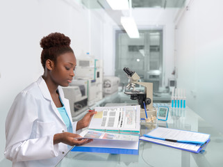 African scientist or medtech works in the laboratory