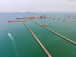 Aerial view of long concrete jetty head into the sea