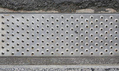 Iron grate of water drain on street.