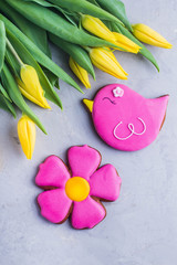 Spring background card cookies and flowers yellow tulips. Easter or Mother day holidays content