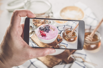 Taking photos of breakfast to phone