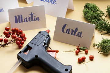 How to make wedding place name cards with handwritten letters and fresh plants.