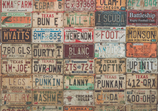 Vintage collage of old American car plates.