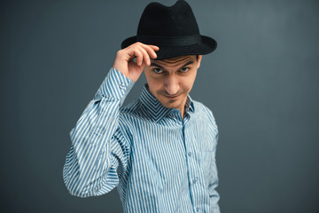 young man with a hat in the studio