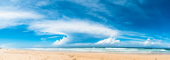 The panoramic view of the ocean beach with beautiful bright cloudy sky in Gold Coast, Australia