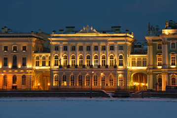 The old building of the Small Hermitage in night illumination in the February evening