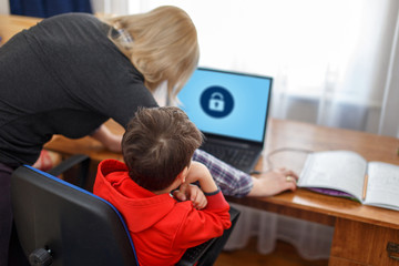 Mother locking on computer for son, parental control