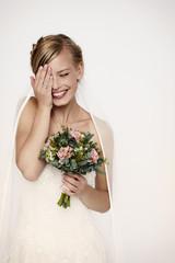 Laughing bride in white wedding dress