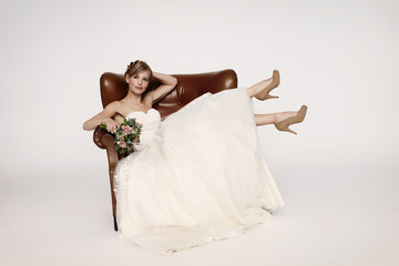 Armchair bride relaxing in studio