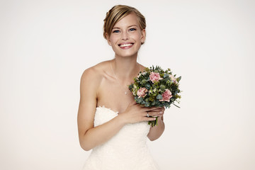 Gorgeous bride holding flowers, portrait