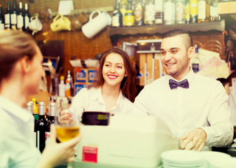 Personnel at a bar