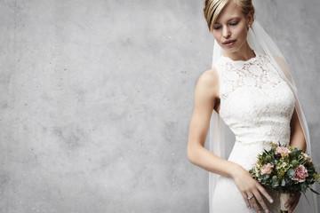 Stunning bride in white wedding dress, studio