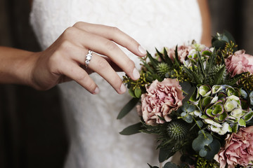 Wedding ring and blooming flowers, close up