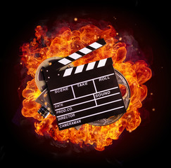 Film equipment in fire, isolated on black background
