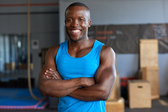 Confident muscular black man smiling in a gym