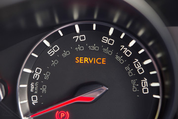 Close Up Of Service Warning Light In Car