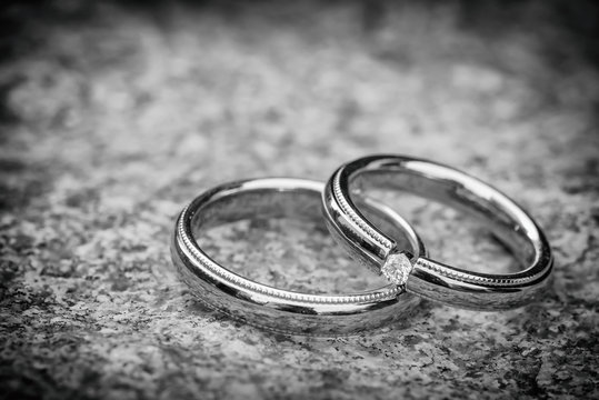 Wedding rings on stone surface, Black and white