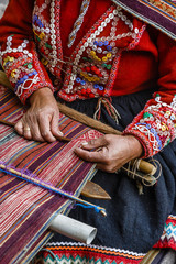 Quechua women weaving a traditional textile, Cuzco, Peru.
