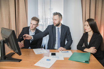 three businessmen two male and female office workers, businessperson thinking about ways to overcome business obstacle, 