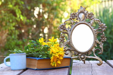 Image of vintage antique classical frame on wooden table