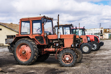Closeup of tractors after plowing.  Wheels covered with mud. Agronomy, agriculture,concept.