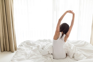 Woman stretching hand at morning