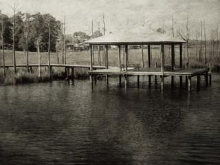 Vintage boat dock on water with vintage look
