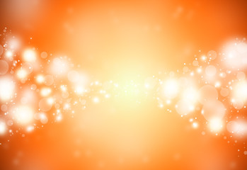 Gold sparkles glitter defocused rays lights bokeh abstract holiday background.