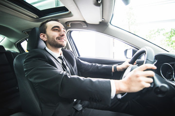 young businessman in his car. Driver of luxuty car. Handsome man drive car.