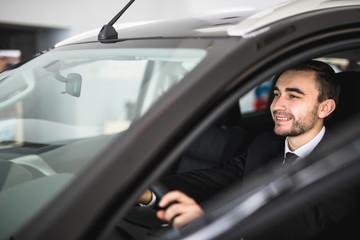 Attractive elegant happy man drive good car