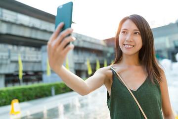 Woman taking selfie in Bangkok city