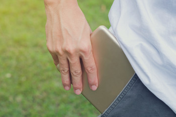 Close up of a hand of a businessman holding a tablet computer,