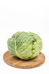 Green fresh cabbage on the kitchen wooden board