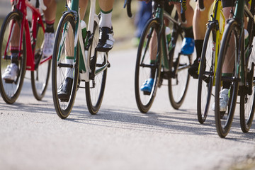 Group of cyclists riding a bike in a cycling race. Racing Bike.