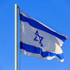Flag of Israel on sunrise
