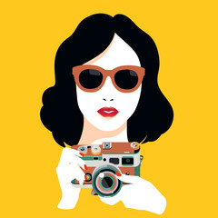 Fashion pretty young smiling woman with retro camera taking photo
