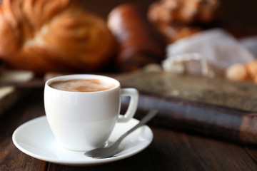 Cup of coffee and different bakery products