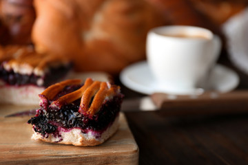 Slice of tasty fruit pie on wooden table