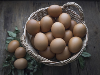 Fresh eggs in basket.