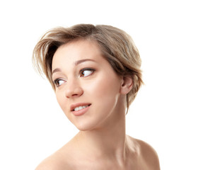 Young woman with trendy hairstyle on white background