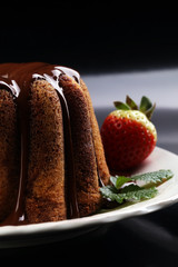 cake for Valentine day with chocolate, brown chocolate and strawberries. Traditional homemade Marble cake - Gugelhupf