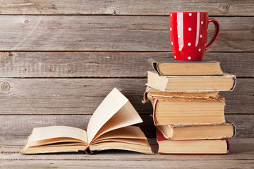 Old books and coffee cup