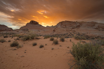 Sun setting behind mountain at Valley of Fire State Park