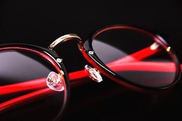Fashion red black eye glasses isolated on black background